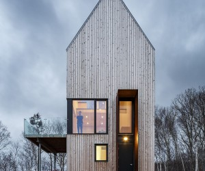 A Cabin Unlike Any Other Overlooks Rugged Coastline and Forest Canopy
