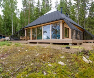 A Finnish Retreat Features a Pyramidal Roof and a Glass Wall Facade