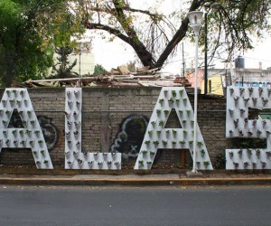 A new outdoor sign for a community garden in Iztacalco by Sequence Unlimited for Alas