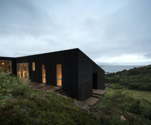 A Wooden Hillside Cabin by Kappland Arkitekter