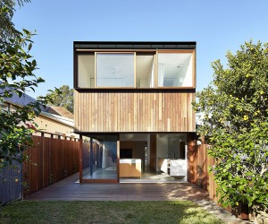 Box-Like Rear Extension in Wood Adds Functional Modernity to this Brick House