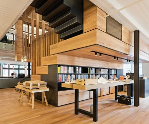 Box-Style Events Space with Tiered Seating Defines This Office