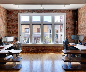 Century-Old Building Altered into Multi-Level Modern Industrial Office