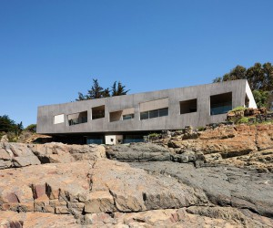 Chilean Concrete Residence Adorning a Steep Slope