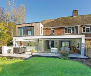 Classic English Home with Brick Faade Acquires a Nifty Modern Extension