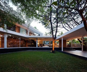 Contemporary Bangkok Residence Defined by Interconnected Glass Volumes