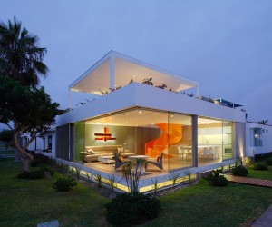 Contemporary house with an orange staircase and rooftop