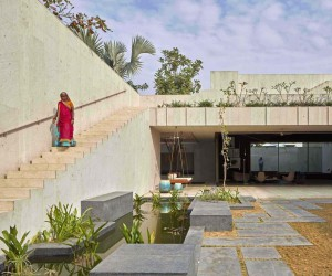 Cruciform Shaped House with Living Spaces Immersed in Secret Garden Courtyards