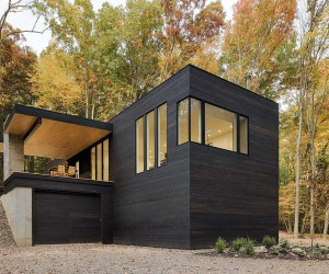 Custom Charred Cedar Exterior Cloaks a Car-Lovers Dream Retreat