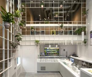 Custom Metallic Grid Brings a Vibrant Green Display to This London Caf