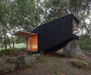 Discover Tranquility: Tiny Forest Retreat that Rests on Giant Boulders