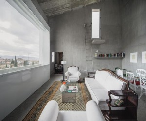 Elisa Valero Arquitectura Designed Eight Experimental Apartments with Exposed Concrete Walls