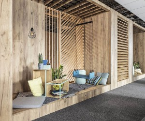 Embracing Wood: Smart Acoustics and Cozy Aesthetics Shape Office in Poznan
