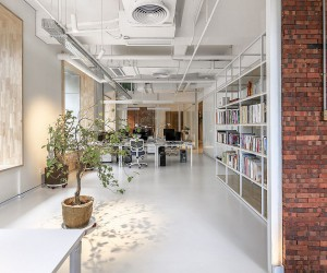 Exposed Brick and Natural Greenery Bring Freshness to this Chinese Office