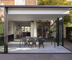 Glass Extension Breathes Life into 1920s Brick House in the Hague