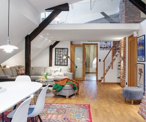Joyful Attic Apartment Overlooking Colorful Roofs in Gothemburg, Sweden