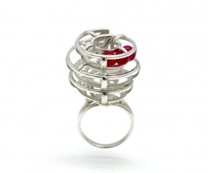 Kinetic Ring - rolling rubies with every movement of the wearer