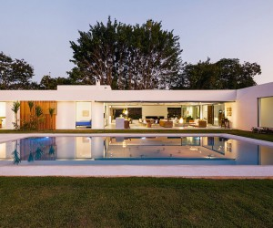 L-Shaped Family Home Charms with a Stunning Private Courtyard and Pool