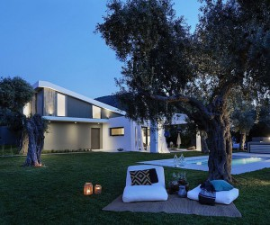 L-Shaped Villa Featuring Large Openings, Clean Surfaces and Bohemian Luxury