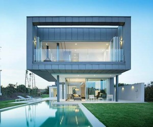 Luxurious Two-Story Spanish Villa Cantilevers Over a Pool