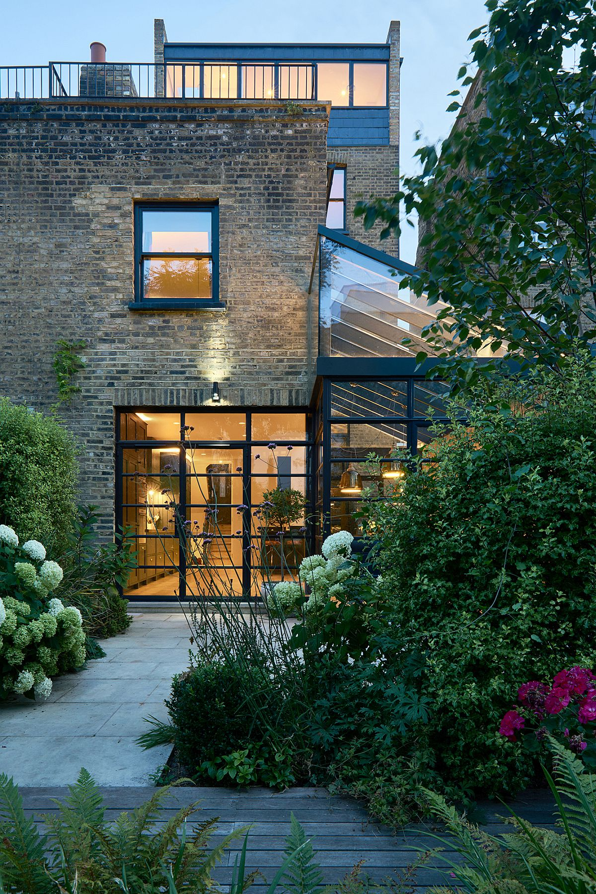 Modern extension using crittall windows refreshes for The terrace house book