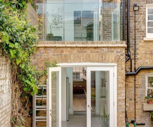 Nifty Extension with Walk-On Skylights Enlivens this Terrace House