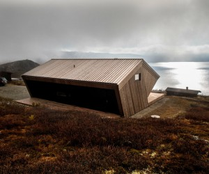 Norwegian Mountain Cabin with a Distinctive, Hood-Like Roof