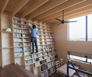 Oblique Walls Create a Cool Double Height Bookshelf in this Japanese Home