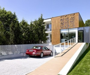 Perforated House Adapting Its Modern Look to Art Nouveau Design Features