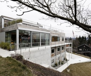 Reconstructed Multi-Level Hillside Home in Oslo Wrapped in Concrete and Wood