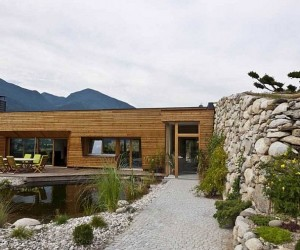 Scenic Landscape and Natural Materials Shape Elegant Italian Residence