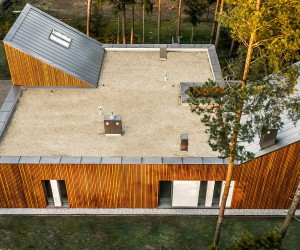 Serene Forest Retreat Draped in Wood with Ingenious Functional Form