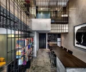 Singapore Loft Unified By a Giant Cage