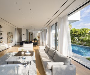 Sliding Glass Wall Used for Remarkable Indoor-Outdoor Connection