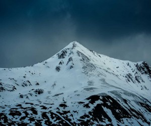 Snowy Hilltops: Majestic Mountainscapes in Scottish Highlands by Marina Weishaupt