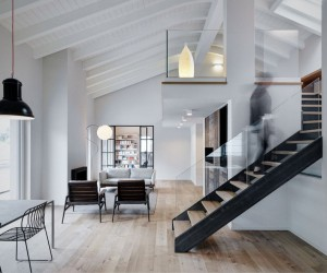 Stefano Vigan Designed a Double-Height Loft with an Industrial Personality