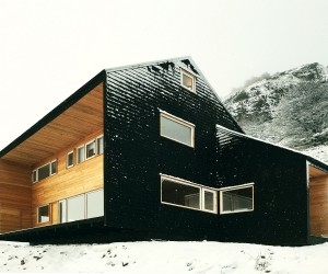 Sustainable Mountain Home in the Andes with a Dashing Dark Exterior