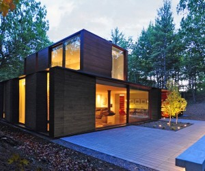 Sylvan Retreat: textured wood structure with a green roof