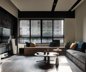 Taichung Apartment Featuring Dark Hues and an Elegant Material Palette