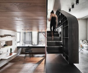 Tiny Apartment with Loft Level and Adaptable Wall Makes a Big Impact