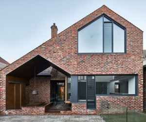Tudor Revival Residence in Eastern Melbourne by Warc Studio