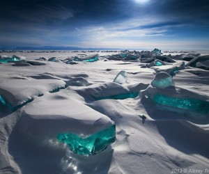 Turquoise Ice Splintering Through the Surface of Worlds Largest Lake