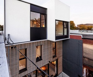 Twin Rooftop Volumes Rejuvenate 1930s Duplex in Montreals Little Italy