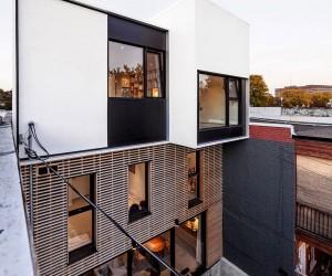 Twin Rooftop Volumes Rejuvenate 1930s Duplex in Montreals Little Italy