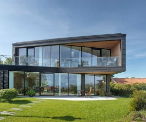 Villa U in Denmark: A Home Dressed in Dark Patinated Zinc and Glass