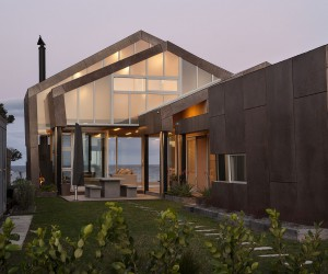 Weathered Steel and Wood Home on Oceans Edge Inspired by Life on the High Seas
