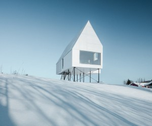 Winter Chalet on Stilts Rises Above a Snow-Laden Slope in Quebec